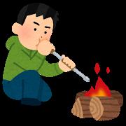 火吹き棒を使う人のイラスト