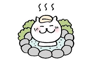 温泉でのんびりするネコ